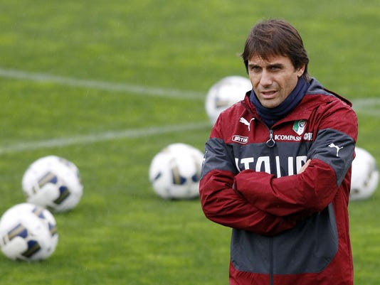 Italian national soccer team's coach Antonio Conte watches his players, during a training session with the team at the Coverciano Training Center, near Florence, central Italy, Monday, Nov.10, 2014. Italy will play Croatia in Milan on Sunday in a Euro2016, Group H, qualifying round soccer match. It's the first time that the Azzurri coach Antonio Conte has included Balotelli since taking over from Cesare Prandelli after Italy's first-round elimination from the World Cup. (AP Photo/Fabrizio Giovannozzi)
