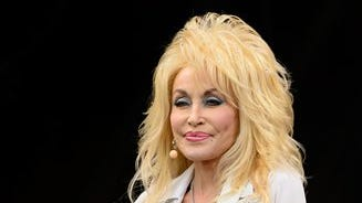 U.S singer Dolly Parton performs at Glastonbury music festival, England, Sunday, June 29, 2014. Thousands of music fans have arrived for the festival to see headliners Arcade Fire, Metallica and Kasabian.