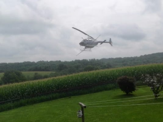 """Ellen Marble of Hopewell Township submitted this photo to the YDR Nature and Scenery gallery. Marble writes, """"Close call to spray the fields!"""""""