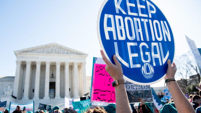 In this file photo taken on March 04, 2020, pro-choice activists supporting legal access to abortion protest during a demonstration outside the Supreme Court in Washington, D.C., as the court hears oral arguments regarding a Louisiana law about abortion access in the first major abortion case in years.