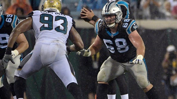 FILE - In this Aug. 24, 2017, file photo, Carolina Panthers guard Andrew Norwell (68) looks to block against Jacksonville Jaguars defensive lineman Calais Campbell (93) during the first half of an NFL preseason football game in Jacksonville, Fla. A person familiar with negotiations said Tuesday, march 13, 2018, that the Jacksonville Jaguars are poised to sign All-Pro guard Andrew Norwell to a five-year, $66.5 million contract when free agency opens Wednesday. Norwell's deal includes $30 million guaranteed, the person said. (AP Photo/Phelan M. Ebenhack, File)