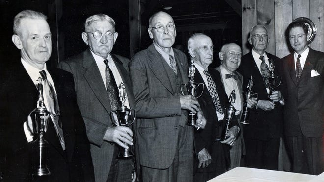 Six life members of the New Hamburg Engine Co. were honored in May 1952 with trophies at the company's annual installation dinner. From left are Frank J. Nevins, Atwill Churchill, Conklin Morey, William Workman, Captain Frank Drake and Arthur Van Norstrand. Surrogate W. Vincent Grady, at far right, presented the trophies on behalf of the company.