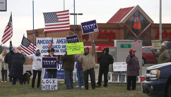 A group of Trump supporters took to the corner of West Forth Street and Lexington-Springmill Road in Ontario showing their support for the 45th president.