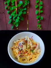 Don Reinhardt Jr.'s Asiago chicken is made with #3 spaghetti, chicken, prosciutto, mushrooms, red onion and garlic tossed in an Asiago cheese sauce.