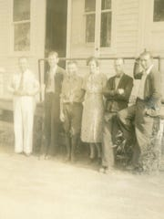 Shown in 1938 in front of the River Street post office in Milton are postal employees Charles King, LC Holcombe, EJ Shephard, Irene Barrett, J.M. White and O. Sanderson.