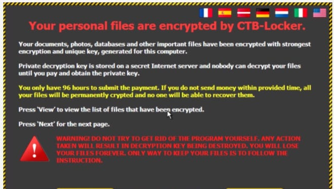 A ransomware screen shot that comes up when users click on scam email claiming to include a Windows 10 upgrade. Cisco Systems researchers first reported the scam.