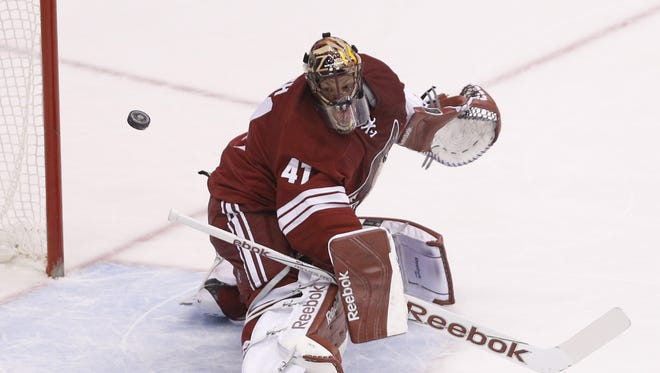 Arizona Coyotes goalie Mike Smith makes a save against the Buffalo Sabres during the first period at Gila River Arena in Glendale March 30, 2015.
