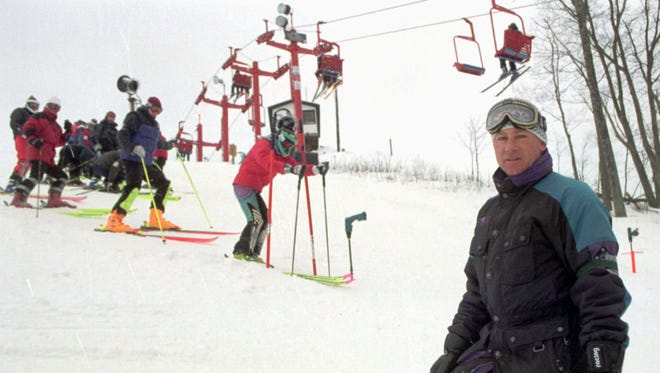 In January 1997, Traverse City ski coach Jerry Stanek pauses during slalom practice on Aweful Aweful at Sugar Loaf Mountain Resort. Laura Wilber is in the starting gate behind him.