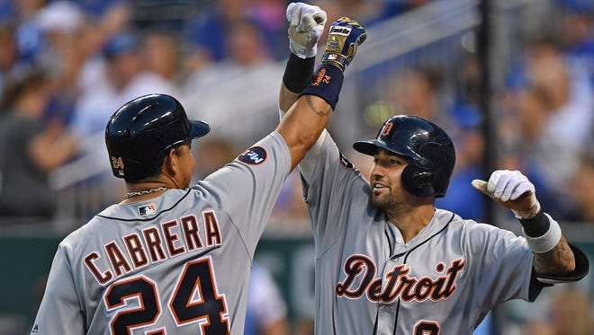 Jul 18, 2017; Kansas City, MO, USA; Tigers third basemen Nick Castellanos celebrates with Miguel Cabrera after hitting a solo home run against the Royals in the fifth inning at Kauffman Stadium.
