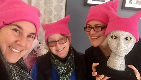 A group of Lancaster women are selling handmade pink cat-ear hats as part of the Pussyhat Project, which supports women's rights.