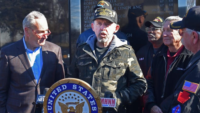 Vietnam veteran Harry Nolte speaks in support of Sen. Chuck Schumer's call for the federal government to add four conditions presumed to be caused by the defoliant Agent Orange to those covered by veterans benefits, during a news conference Friday at the Town of Wallkill Veterans Memorial Park. Schumer listens at left.