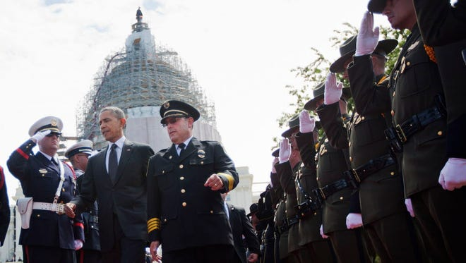 President Obama and Chuck Canterbury, national president of the Fraternal Order of Police, on Capitol Hill on Friday.