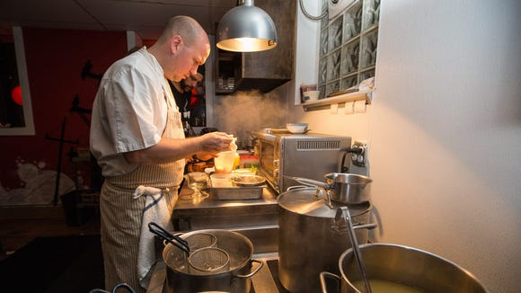 Chef-owner Justin Carlisle preparing a bowl of ramen at Red Light Ramen, 1749 N. Farwell Ave.