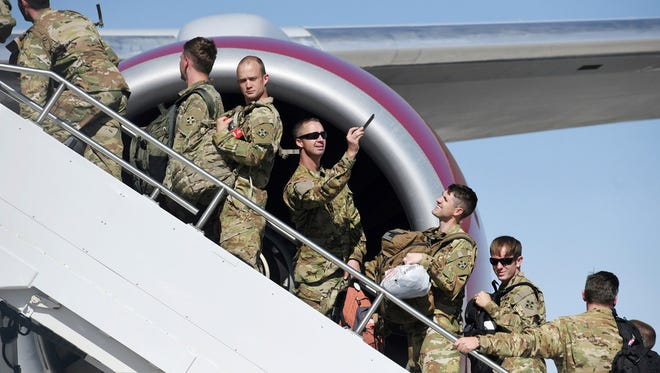 Troops boarding plane boarding a plane to be deployed to Europe, June 11, 2018, Woodland Park, Colo.