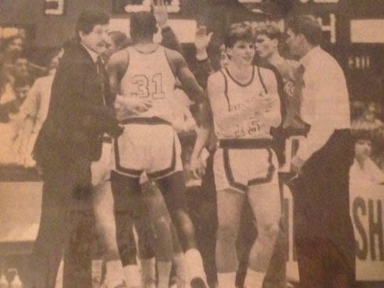 Purcell Marian coach Jim Stoll (far right) instructs