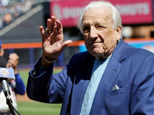 Hall of Famer Ralph Kiner waves to the crowd on April 5, 2012, before announcing the New York Mets starting line-up before an opening day baseball game against the Atlanta Braves at Citi Field in New York.