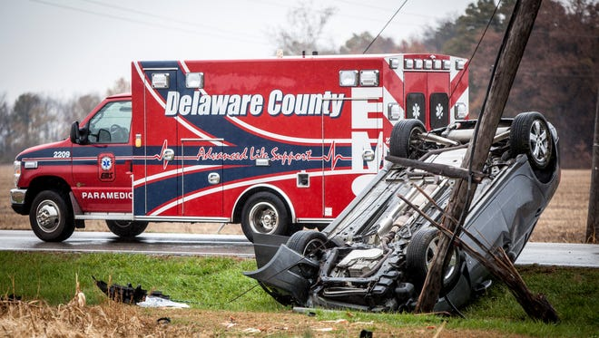 Three people were sent to the hospital for evaluation Tuesday afternoon after a dark gray Pontiac G6 side swiped a Kia Optima and rolled over after striking a utility pole at the intersection of North Wheeling Avenue and West Royerton Road.