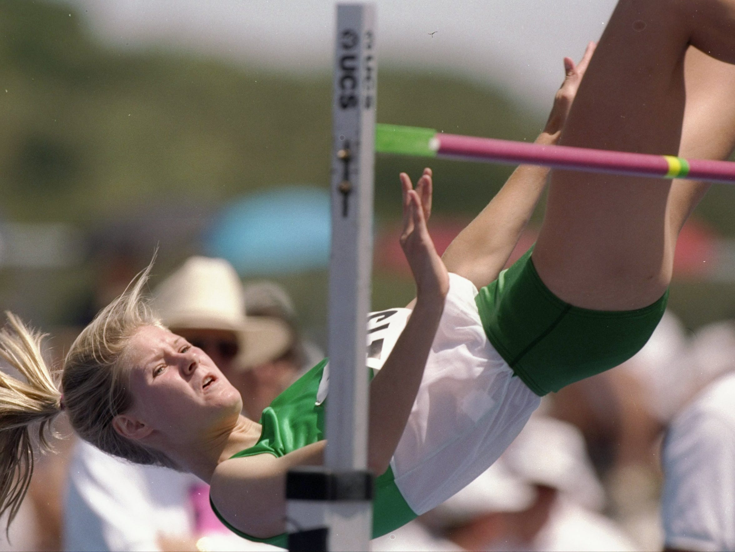 Amy Acuff sails over the bar during the high jump competition