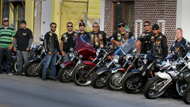 Latino Harley-Davidson enthusiasts, known as Harlistas, gather outside their southside club house. They have  their own unique style of customizing their bikes with a Latin American flair. Locally, they have the Milwaukee chapter of the Latin American Motorcyclist Association, a family-oriented group that gets together for social events at their clubhouse on the city's south side.   Milwaukee Journal Sentinel photo by Rick Wood/RWOOD@JOURNALSENTINEL.COM ORG XMIT: 20088323A