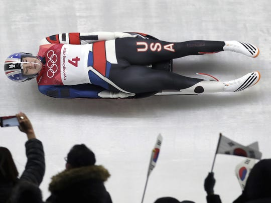 Summer Britcher of the United States competes in her first run during the women's luge competition at the 2018 Winter Olympics in Pyeongchang, South Korea, Monday, Feb. 12, 2018. (AP Photo/Michael Sohn)
