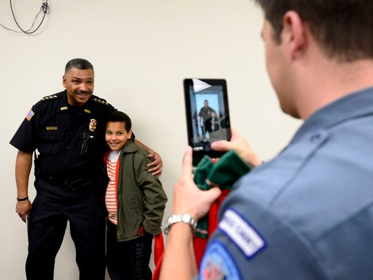 Pensacola Police Chief David Alexander III poses with Brian Wilson at one of the department's annual children's Christmas party.
