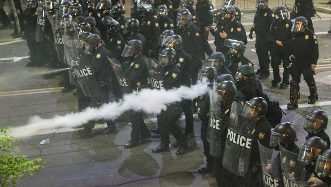 Protesters were gassed by Phoenix police outside of the Phoenix Convention Center following President Donald Trump's visit in Phoenix on Aug. 22, 2017.