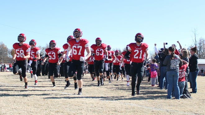Aurora High School's football team takes its home field for a playoff quarterfinal game against Mountain Grove on Saturday, Nov. 14, 2015.