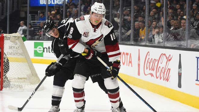 Feb 16, 2017; Los Angeles, CA, USA; Los Angeles Kings center Nic Dowd (26) and Arizona Coyotes center Christian Dvorak (18) battle for the puck during the first period of the game at Staples Center.