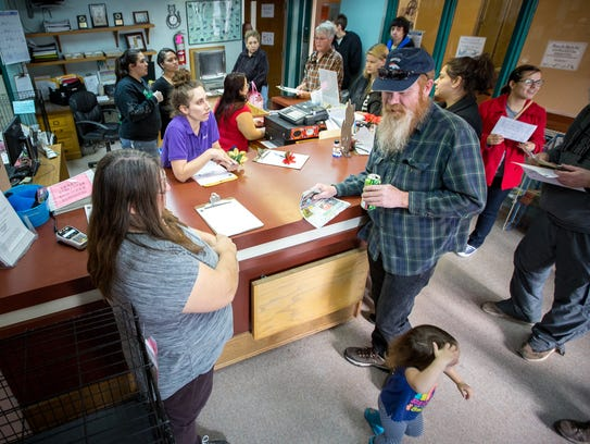 People pack the Animal Service Center of the Mesilla
