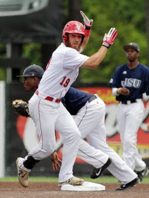 UL's Jace Conrad arrives at second base after hitting a double against Jackson State in an NCAA Baseball Division I Tournament game.