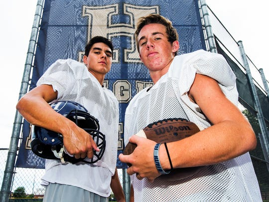 Higley receiver Trent Gilbert (left) and quarterback Mason Crossland were instrumental in the team's 95-75 victory over Apache Junction in 2014.