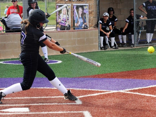 Wylie catcher Minely Avila (7) hits a single during