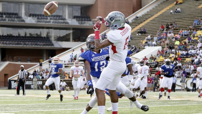 Mississippi's Nigel Knott (12) breaks up a pass during the 29th Mississippi Alabama Football Classic All-Star Game at M.M. Roberts on Saturday.
