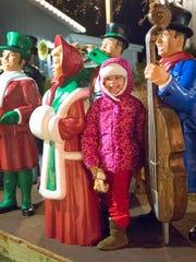 Kalissa Faust, 3, stood among Carolers at the Christmas