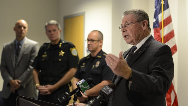 State attorney Bill Eddins, right, announces the arrest of Desiree Tedder for the death of Drulmauert Mims.