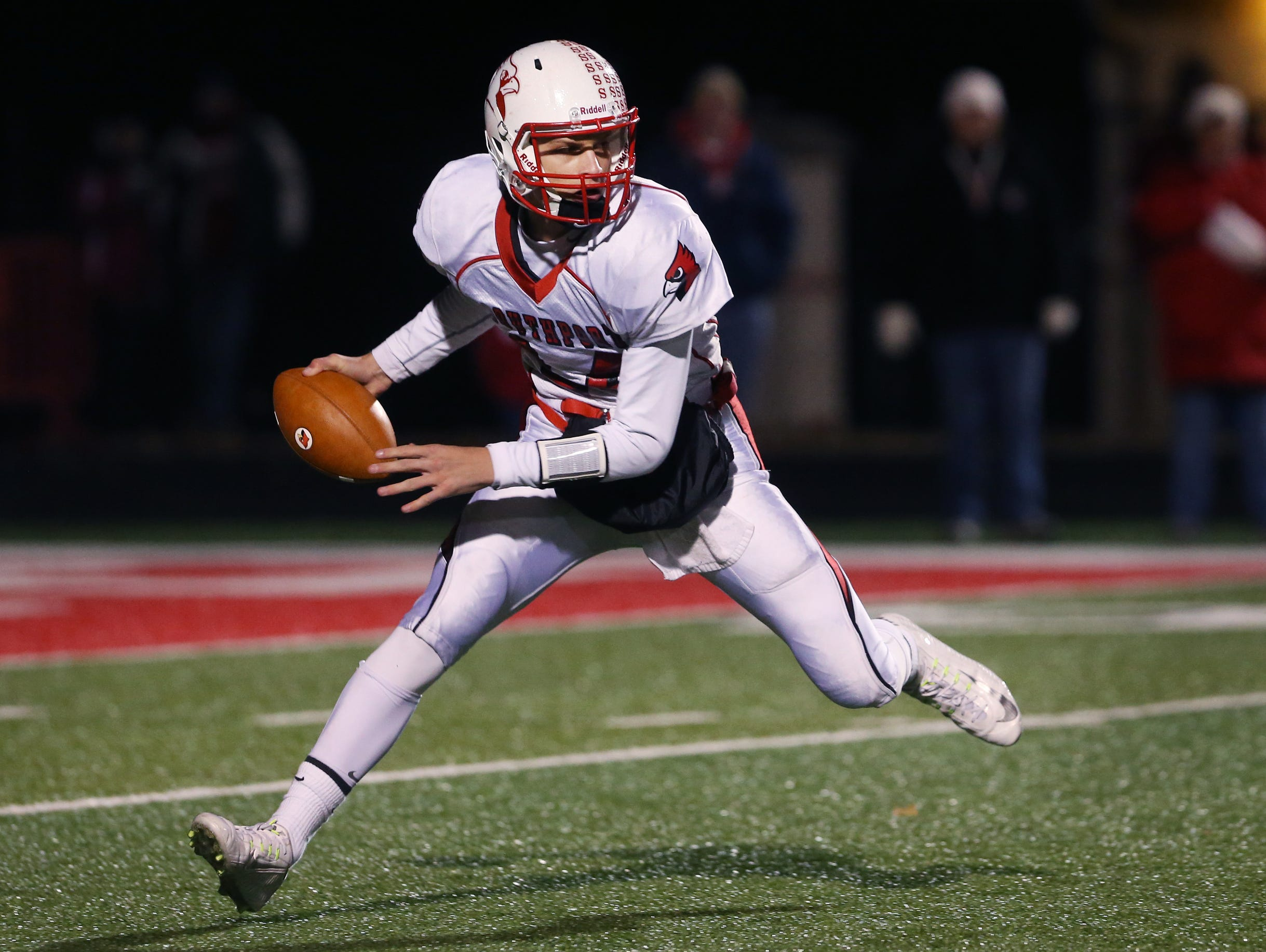 Southport quarterback Luke Johnston scrambles during the Cardinals' 35-22 loss at Center Grove in the 6-A Regional on Friday, Nov. 7, 2014.