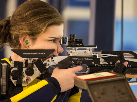 Morgan Phillips aims her rifle during practice at the WVU rifle range in Morgantown, West Virginia on Wednesday, March 29, 2017.