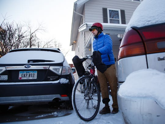 Jeff Wiggins, Des Moines' active transportation planner, prepares to ride through snow Feb. 7 to his job in downtown Des Moines. He was hired in December to get more Des Moines residents to leave their cars at home and find alternative modes of transportation.