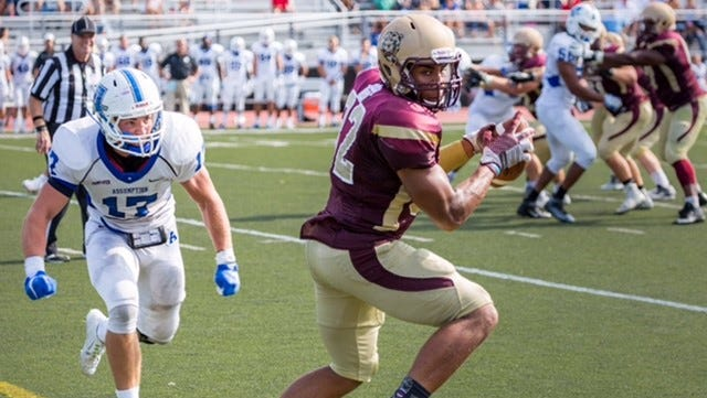 Kutztown University's Kellen Williams, right, a graduate of Chambersburg, has caught 70 passes totaling 710 yards this season.