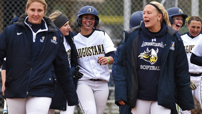 Augustana's Maggie Kadrlik (42) celebrates with teammates after hitting a home run during a first round NSIC softball tournament game against Wayne State Thursday, April 28, 2016, at Sherman Park in Sioux Falls.