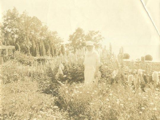 Lila Osgood Webb in her Shelburne gardens, circa 1930s. Shelburne Farms Archives