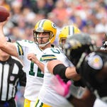 Packers quarterback Aaron Rodgers throws a pass in the first quarter Sunday.