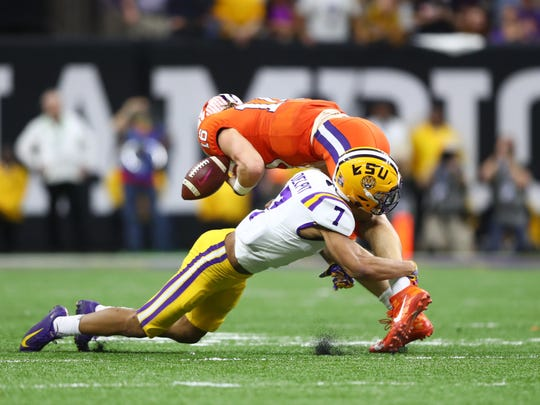 Jan 13, 2020; New Orleans, Louisiana, USA; LSU Tigers safety Grant Delpit (7) tackles Clemson Tigers quarterback Trevor Lawrence (16) in the College Football Playoff national championship game at Mercedes-Benz Superdome. Mandatory Credit: Mark J. Rebilas-USA TODAY Sports