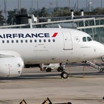 An Air France plane is parked on the tarmac at Paris Charles de Gaulle Airport in Roissy, near Paris, Monday, Sept. 15, 2014. At least half of Air France flights around the world were canceled Monday as pilots kicked off a weeklong strike, angry that the airline is shifting jobs and operations to a low-cost carrier to better keep up with competition.