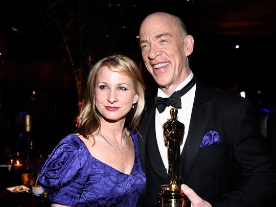 """J.K. Simmons, winner of best actor in a supporting role for """"Whiplash,"""" and his wife, Michelle Schumacher, attend a post-Oscars party."""