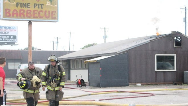 Fares Sabawi/Caller-Times Gregory, Portland and Ingleside firefighters worked together to contain a fire that broke out Wednesday, Aug. 31, 2016, in Mac's Barbecue on State Highway 35.