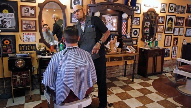 Mark Sinnis, owner of the Beale Street Barber Shop in Peekskill, cuts the hair of Brandon Saba, of Cortlandt Manor. Sinnis is closing shop after 4 years.