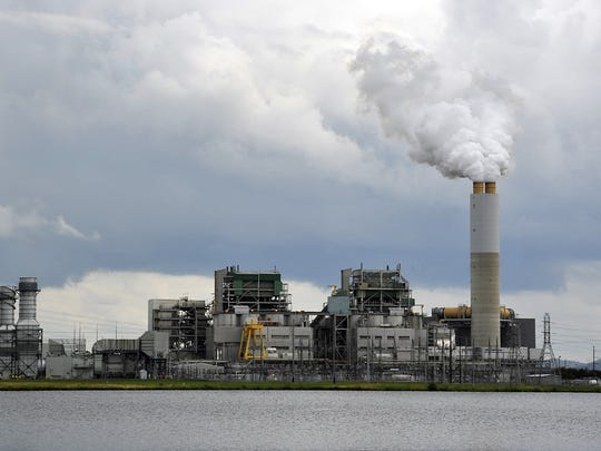 Duke Energy's Lake Julian plant burns coal, but its smokestack scrubber emits mostly steam.