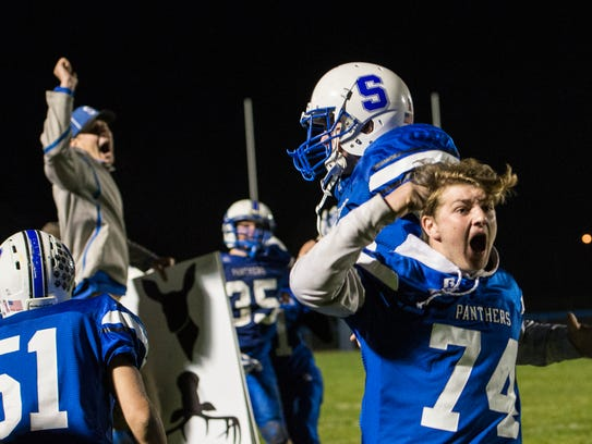 Southeastern's Corbin Ford (74) celebrates after the Panthers scored a go-ahead touchdown with 0:03 remaining in a 44-40 win over Steubenville Catholic Central in a Division VI, Region 23 quarterfinal on Nov. 3, 2017.