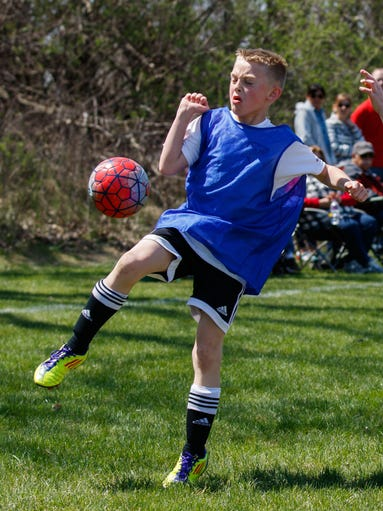 Collin Storbakken, 8, of the Pewaukee Sussex United Soccer Club traps a pass during a U9 match at Armory Park in Sussex on Saturday, April 23, 2016.